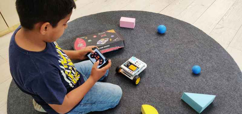 Student Playing Robot Dabble Boy
